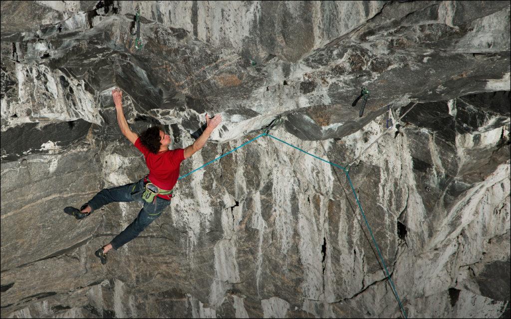Adam Ondra climbing one of the hardest climbing routes in the world at Hanshelleren, Norway.